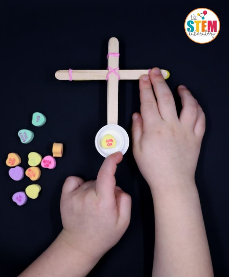 Awesome STEM activity for Valentine's Day! Make conversation heart catapults.