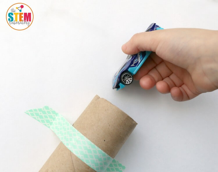 This is such a cool STEM activity for kids! Build Hot Wheels race tracks from paper towel rolls. My boys will love this!