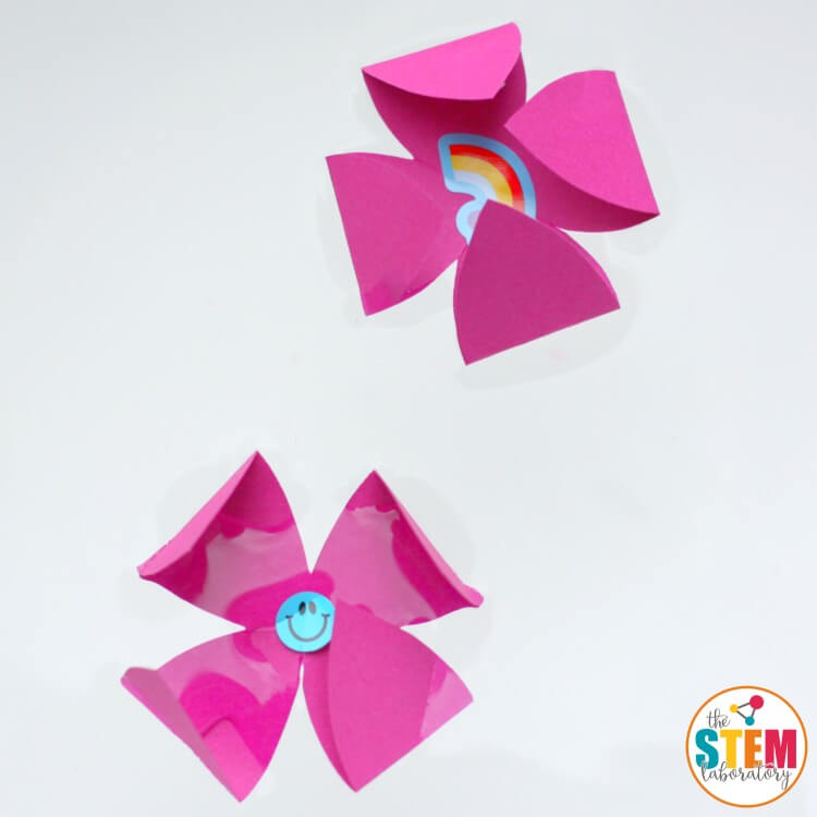 Make flowers out of paper and watch them magically unfold to reveal a surprise! A fun preschool science experiment that children can do all on their own.